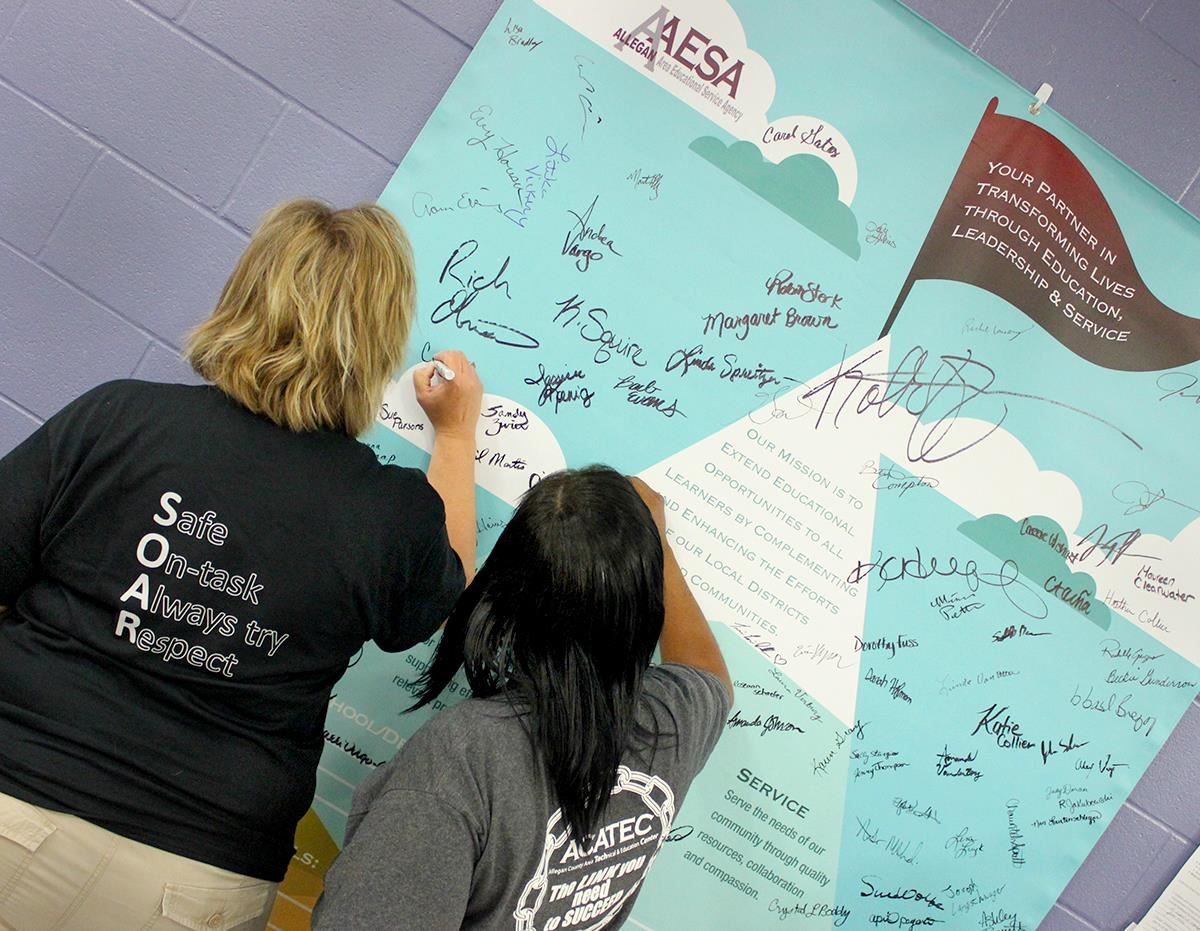 Teachers writing on poster