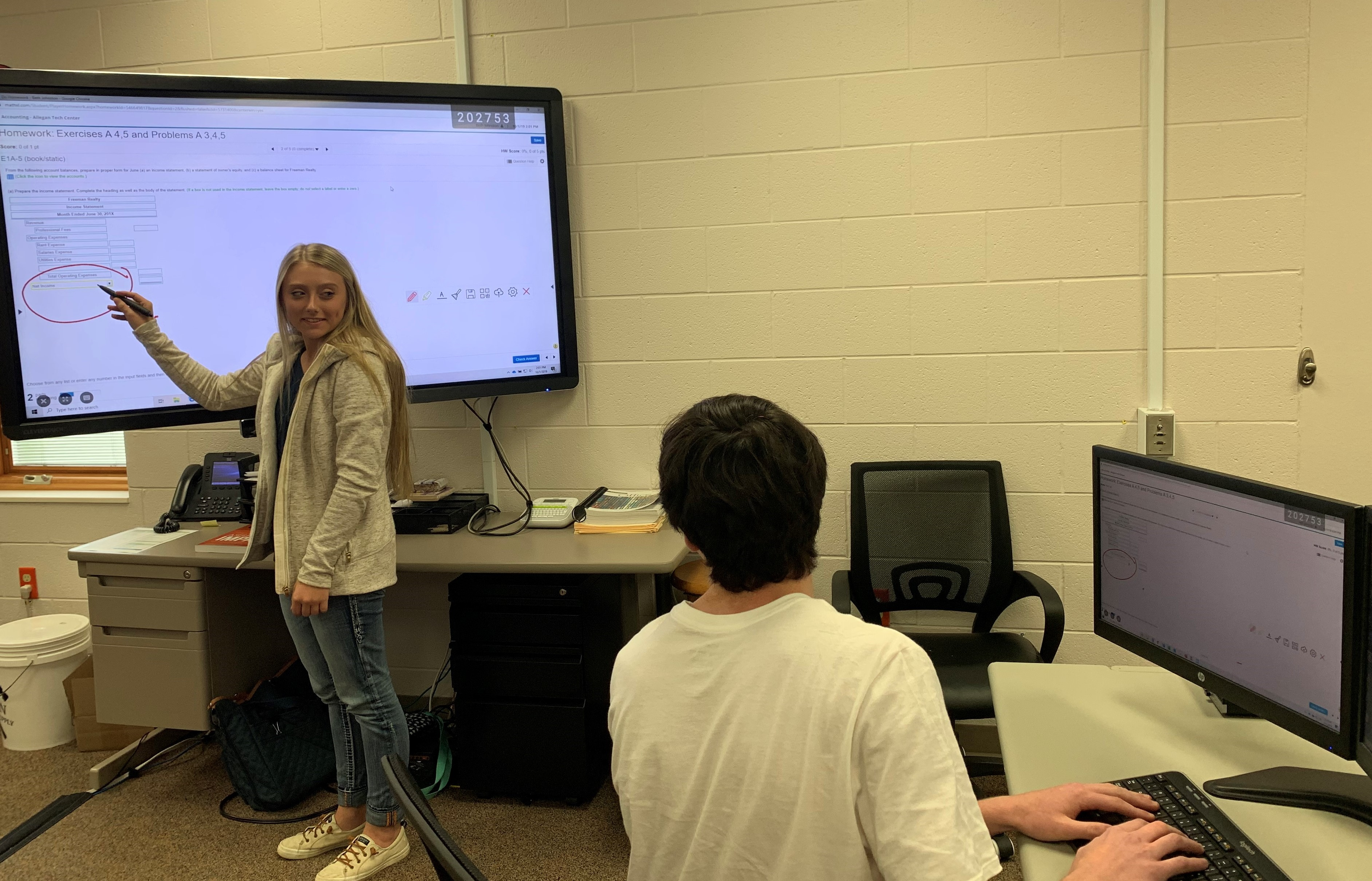 Students from Accounting and Marketing and Management are using a Clevertouch screen
