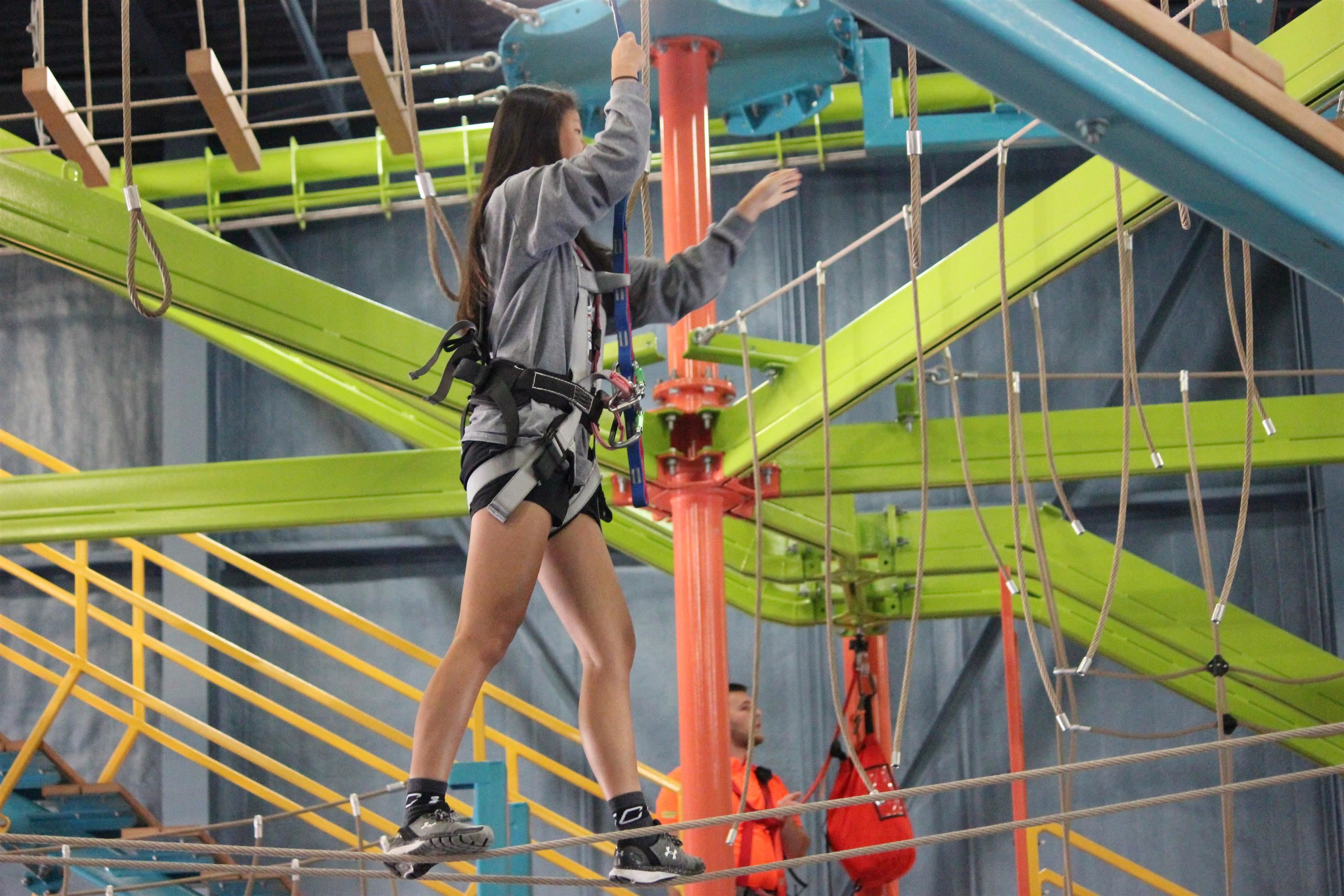 Female student high on ropes course